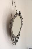 Miroir en fer forgé battu brossé, Epoque ART DECO